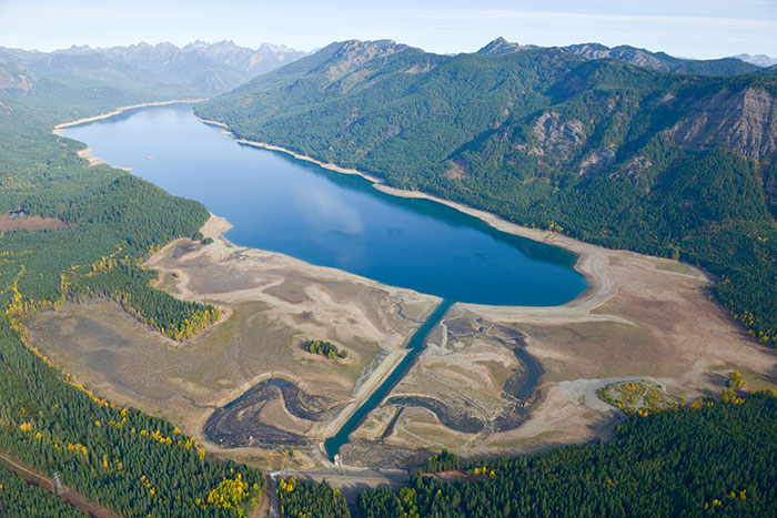 October 2015 drought at Kachess Reservoir looking at Kachess Dam and outlet works channel with the reservoir in the distance.