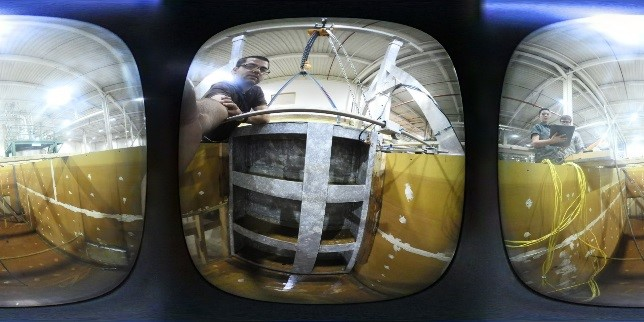 Reclamation researchers perform 360° image capture of fabricated test gate for use in photogrammetric analysis and camera evaluation.