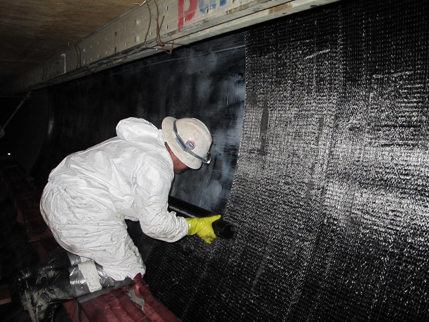 Pre-impregnated CFRP sheets applied to interior walls of PCCP.