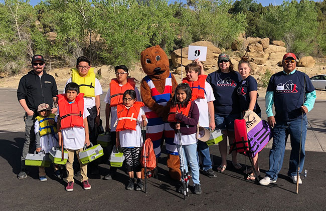 Photo of Navajo Lake C.A.S.T. for kids group with Otto the Otter