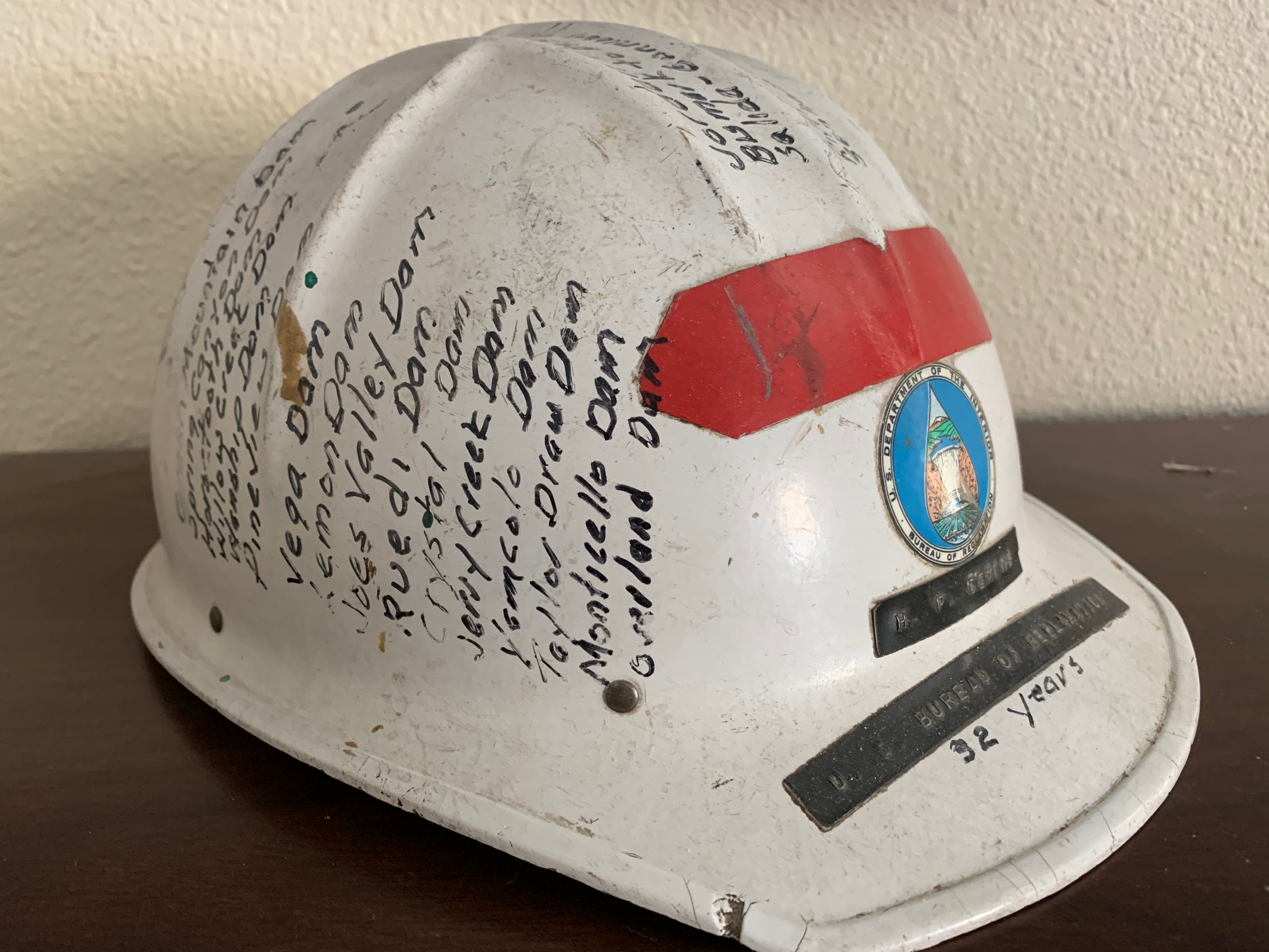 Chick's hardhat, it was a retirement gift that lists all the dams and other facilities he worked on in his career. Bart proudly displays it in his office.