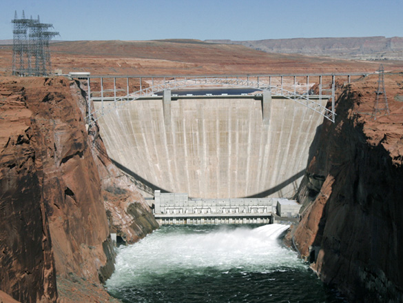 Glen Canyon Dam with all four bypass tubes open.